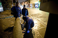 James Anderson, a member of the the Derby Street Pastor team, clearing up broken glass while on patrol in Derby city centre. Street Pastor was pioneered in London in January 2003 and Derby Street Pastors is a partnership of 25 local churches, Derbyshire Police, local council and various groups concerned with city centre street business and safety. Each Street Pastor team member works a minimum of one night a month, usually from 10pm to around 4am.