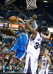 November 29, 2009; Sacramento, CA, USA;  New Orleans Hornets guard Marcus Thornton (5) shoots past Sacramento Kings forward Jason Thompson (34) during the second quarter at the ARCO Arena. Sacramento defeated New Orleans 112-96.