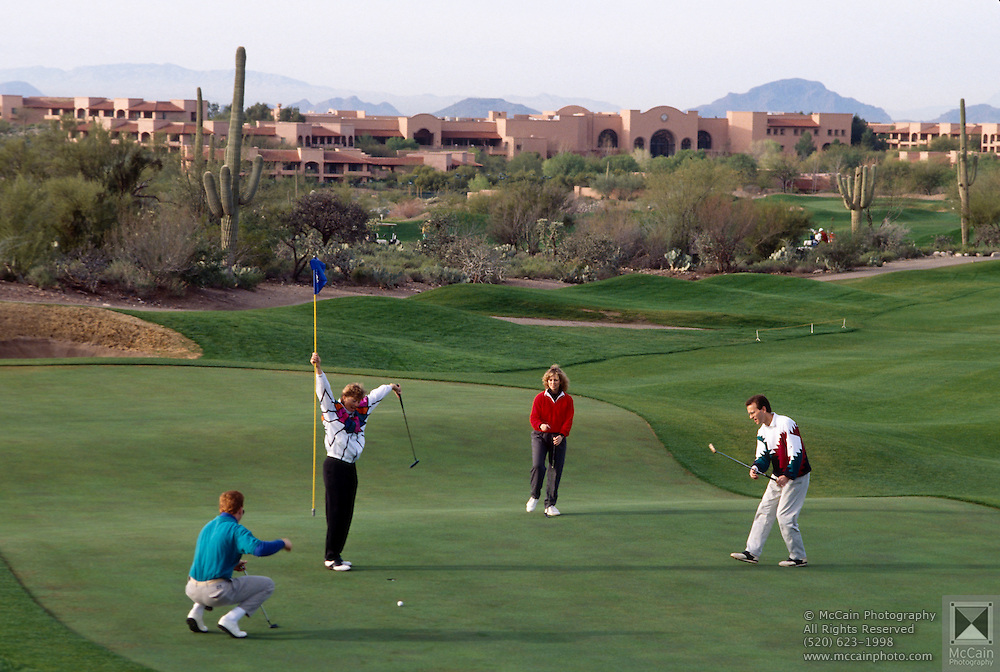 Foursome golfing on fairway, Canyon hole #1, Westin La Paloma. ©1993 Edward McCain. All rights reserved. McCain Photography, McCain Creative.