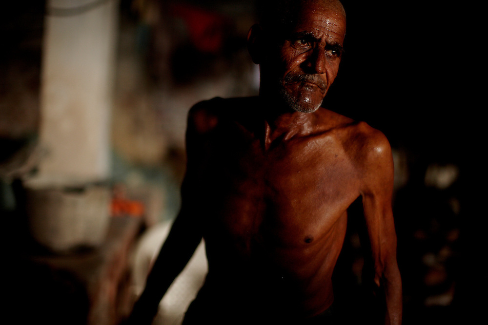 Saktur Prasad, tannary worker, Dalit..At the tannaries of Kanpur the only workers are Dalits. The dirty work of dealing with dead animals is not for everyone are by tradition considered dirty people. .?The caste system in India was abolished by law 60 years ago, but is still deeply rooted in society where it is difficult but not impossible to move to a socially better place.?.Photo by: Eivind H. Natvig/MOMENT