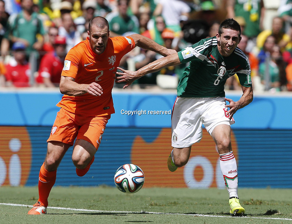 29.06.2014. Fortaleza, Brazil. Mexicos Hector Herrera with Netherlands s Ron Vlaar during a Round of 16 match between Netherlands and Mexico of 2014 FIFA World Cup at the Estadio Castelao Stadium in Fortaleza, Brazil, on June 29, 2014.