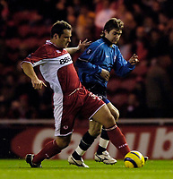 Photo: Jed Wee.<br />Middlesbrough v Dnipro. UEFA Cup. 03/11/2005.<br /><br />Middlesbrough's Mark Viduka (L) tries to get past Dnipro's Oleg Shelayev.