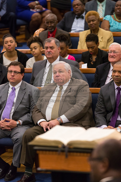 North Charleston Mayor Keith Summey (front center) and North Charleston Police Chief Eddie Driggers (rear center) listen as Rev. Al Sharpton addresses a healing service at Charity Missionary Baptist Church April 12, 2015 in North Charleston, South Carolina. Sharpton spoke following the recent fatal shooting of unarmed motorist Walter Scott police and thanked the Mayor and Police Chief for doing the right thing in charging the officer with murder.