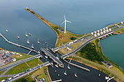 Nederland, Noord-Holland, Den Oever, 05-08-2014; Afsluitdijk met Stevinsluizen gezien vanuit Den Oever. Links Waddenzee, rechts IJsselmeer.<br /> Enclosure Dam with Stevin Locks seen from Den Oever. Port of Den Oever, left Waddenzee, IJsselmeer right.<br /> luchtfoto (toeslag op standaard tarieven);<br /> aerial photo (additional fee required);<br /> copyright foto/photo Siebe Swart.