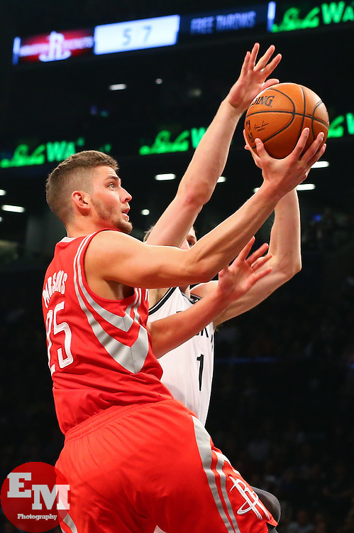 Apr 1, 2014; Brooklyn, NY, USA; Houston Rockets forward Chandler Parsons (25) drives to the basket against Brooklyn Nets forward Mason Plumlee (1) during the second quarter at Barclays Center.