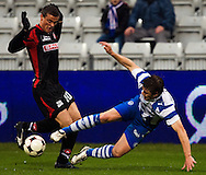 DK -  Odense..14/03/09.Superligakamp Fionia Park.:.OB - FC Midtjylland...Thomas Helveg lggende i nærkamp med FCMs  Mikkel Thygesen ..Photo: Johnny Anthon Wichmann