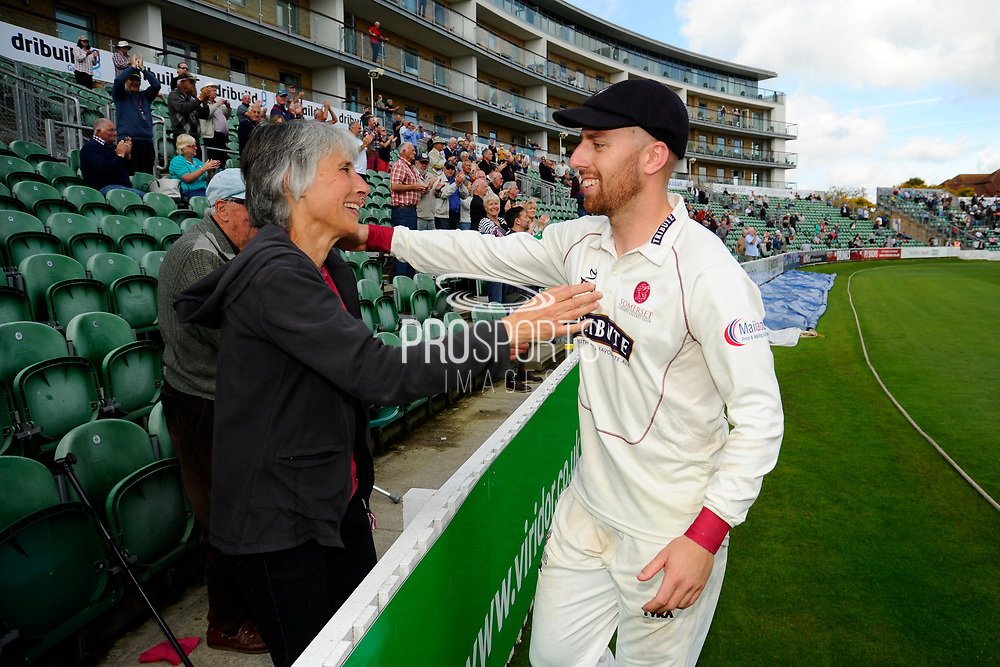 Jack Leach of Somerset goes to hug his mother while on a lap of honour after beating Middlesex to secure survival in Division 1 of the Specsavers County Champ Div 1 match between Somerset County Cricket Club and Middlesex County Cricket Club at the Cooper Associates County Ground, Taunton, United Kingdom on 28 September 2017. Photo by Graham Hunt.