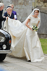 The bride the Hon.Alexandra Knatchbull at the wedding of the Hon.Alexandra Knatchbull to Thomas Hooper held at Romsey Abbey, Romsey, Hampshire on 25th June 2016