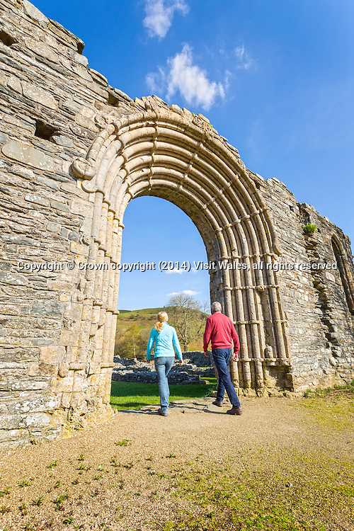 Couple at west doorway of the abbey church<br /> Strata Florida Abbey 2(25)<br /> Cadw Sites<br /> SAMN:CD001<br /> NGR: SN746657<br /> Ceredigion<br /> Mid<br /> Abbeys<br /> Medieval<br /> Religious, Ritual and Funerary<br /> Faith Tourism<br /> Historic Sites