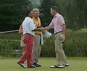 2007 Boyne Tournament of Champions winner Michael Harris of Troy (right) is congradulated by runner up Brian Cairns from the Highland Golf Center (left) and Bob Ackerman from Bob Ackerman Golf after holing out on the par 5 18th of Boyne Mountains Alpine course.