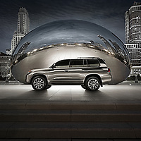 Lexus SUV parked with The Bean in Milennium Park, Chicago, IL.