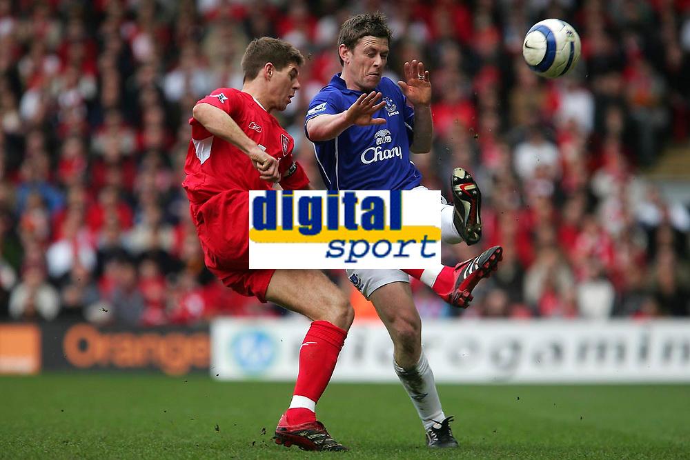 Photo: Andrew Unwin.<br />Liverpool v Everton. The Barclays Premiership. 25/03/2006.<br />Everton's Gary Naysmith (R) looks to block Liverpool's Steven Gerrard.