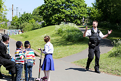 © Licensed to London News Pictures. 06/05/2020. London, UK. Police talk to members of public in Markfield Park, Tottenham in north London. The coronavirus lockdown continues to slow the spread of COVID-19 and reduce pressure on the NHS.  Photo credit: Dinendra Haria/LNP