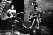 Two young boys from the Music for Hope project taking part in a music lesson led by UK based tutor Katherine Rogers.<br /> Community of Nueva Esperanza,<br /> Bajo Lempa, El Salvador. 1999