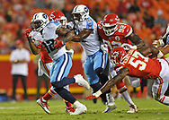 Running back David Fluellen #32 of the Tennessee Titans rushes up field against the Kansas City Chiefs during the first half at Arrowhead Stadium in Kansas City, Missouri.