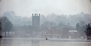 Henley, Great Britain,  General Views,  Henley Reach, and  Church Tower, Henley Town,  Single scull trainging in the early morning mist, Henley on Thames Oxfordshire, Great Britain. Thursday,  21/01/2010. [Mandatory Credit. Peter Spurrier/Intersport Images]