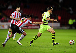 Sheffield United's Michael Doyle pulls Yeovil Town's Edward Upson's shirt - Photo mandatory by-line: Dougie Allward/JMP - Tel: Mobile: 07966 386802 03/05/2013 - SPORT - FOOTBALL - Bramall Lane - Sheffield - Sheffield United V Yeovil Town - NPOWER LEAGUE ONE PLAY-OFF SEMI-FINAL FIRST LEG