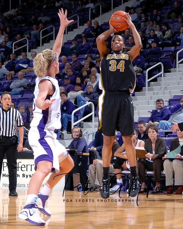 Missouri guard Tiffany Brooks (34) puts up a shot over Kansas State's Danielle Zanotti during the first half at Bramlage Coliseum in Manhattan, Kansas, January 13, 2007.  K-State beat the Tigers 81-66.