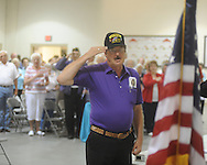 Gail Wilson salutes the flag during a Memorial Day service at the National Guard Armory in Oxford, Miss. on Monday, May 31, 2010.