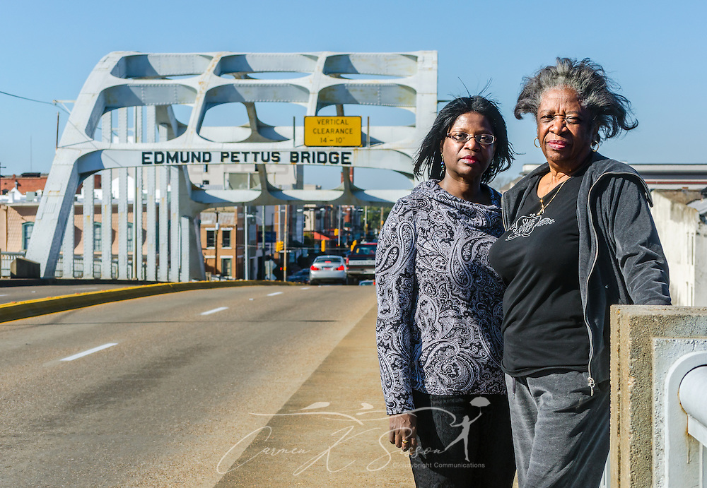 "Writer and playwright Cheryl L. Davis, left, stands with her mother, Bruce Davis, on the Edmund Pettus Bridge, Feb. 7, 2015, in Selma, Alabama. The women traveled from New York to see the historic site where civil rights activists were attacked by law enforcement during ""Bloody Sunday,"" March 7, 1965. Cheryl L. Davis is currently working on ""Bridges,"" a musical that mentions the 1965 civil rights march from Selma to Montgomery. The production is slated for production February 2016 in California. (Photo by Carmen K. Sisson/Cloudybright)"