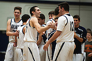 Burlington's Asmin Mostarlic (12) and the rest of the team congratulate Josh Hale (25) on scoring his 1000th point during the boys basketball game between Brattleboro and Burlington at Burlington High School on Saturday afternoon December 19, 2015 in Burlington. (BRIAN JENKINS/for the FREE PRESS)