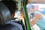 A man haggles for taxi rides to Guardalavaca<br />