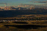 PINEDALE, WY - Overlooking Pinedale, WY, a town of 1400 residents which is the governing seat of Sublette County whose residents number 6400 on August 20, 2005. Farms and ranches are being broken up and sold typically as two, five, 10, and 20 acre lots on septic systems and well water. One of the local sayings is that the escalating real estate prices are a result of the billionaires moving into nearby Jackson, WY, who are pushing out the millionaires who then move to Pinedale. According to realtor Travis Bing, anything one 'would want to buy' starts at about $200,000 with many homes selling for $450,000 and up. Pinedale currently has the lowest unemployment rate in the state and is experiencing another boom cycle both in real estate and in energy as natural gas production in two nearby gas fields ramps up for year-round production..