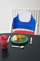 High chair at table with child's dinner