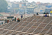 INDIA, OLD DELHI:  People gathered on the steps of the Jama Masjid Mosque in Old Delhi with the skyline of the city in the background.