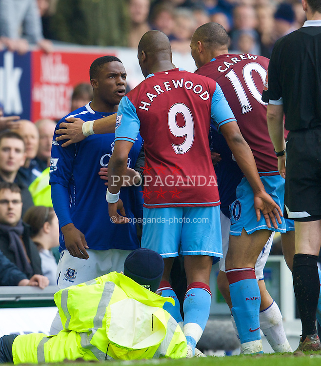 LIVERPOOL, ENGLAND - Sunday, April 27, 2008: Everton's Victor Anichebe clashes with Aston Villa's Marlon Harewood during the Premiership match at Goodison Park. (Photo by David Rawcliffe/Propaganda)