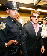 Actor Tom Cruise boards a New York City subway train during a promotional tour of New York for his new movie 'Mission Impossible 3' , Wednesday 03 May 2006. Cruise is attending a number of different events around the city and travelling by a number of different forms of transportation.