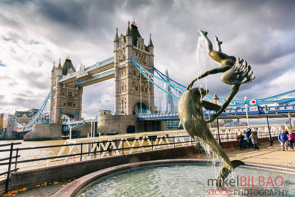 Tower Bridge, Girl with a dolphin fountain, and River Thames. London, United Kingdom, Europe