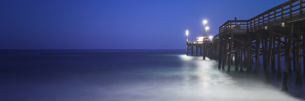 Newport Beach Balboa Pier at night panorama photo. Newport Beach is a popular beach city in Orange County Southern California. Copyright ⓒ 2017 Paul Velgos with All Rights Reserved.