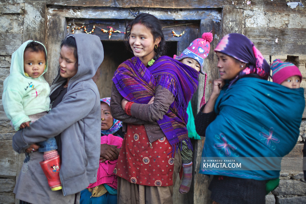 Young mothers from Nepal with their children at a village in Kullu. Many Nepali families move to Himachal in search for jobs and take care of the Apple Orchards