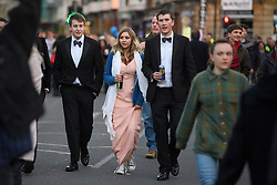 © London News Pictures. 01/05/2016. Oxford, UK. Oxford University students and members of the public celebrate May Day in the early hours of the morning near Magdalen Bridge in Oxford, Oxfordshire. This year people were again prevented from jumping from the bridge in to the water due to serious injuries sustained at a previous years event . Photo credit: Ben Cawthra/LNP
