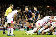 Ospreys scrum half Rhys Webb and Stade Francais scrum half Will Genia wait for the ball to come out of the scrum during the European Challenge Cup match between Ospreys and Stade Francais at Principality Stadium, Cardiff, Wales on 2 April 2017. Photo by Andrew Lewis.