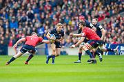 Jaco van der Walt (#10) of Edinburgh Rugby looks to break between Dave Kilcoyne (#1) and Jean Kleyn (#4) of Munster Rugby during the Heineken Champions Cup quarter-final match between Edinburgh Rugby and Munster Rugby at BT Murrayfield Stadium, Edinburgh, Scotland on 30 March 2019.
