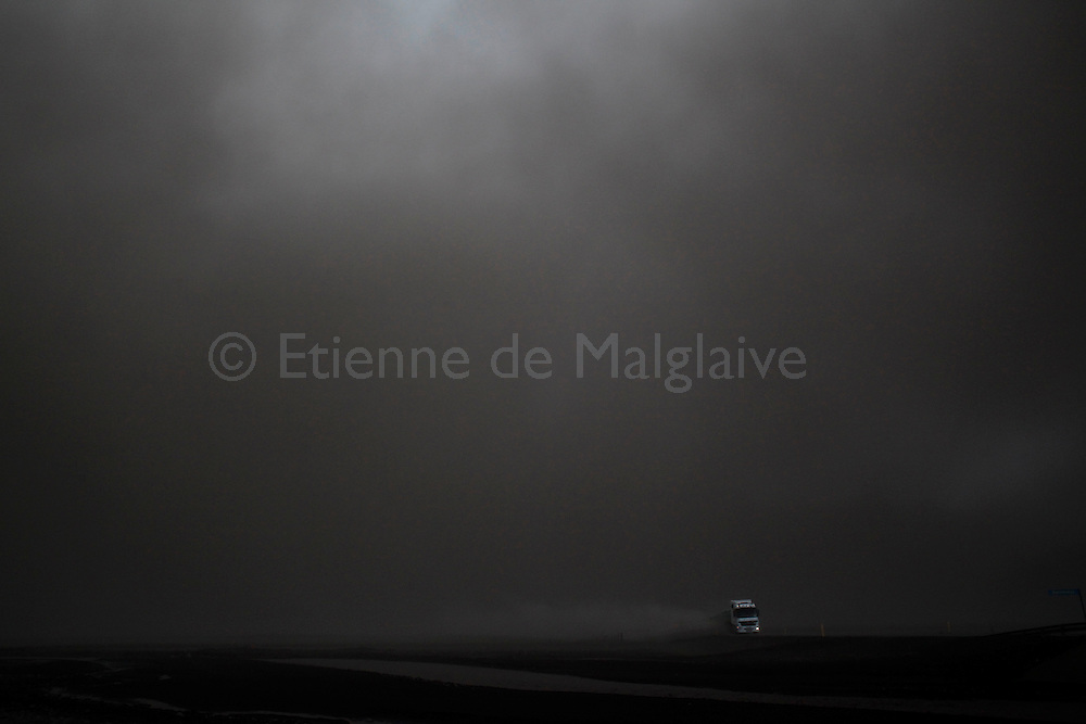 Road traffic under a dark ash cloud  spewed by Iceland's Eyjafjallajokull volcano that blacked out visibility under the plume. Picture taken in full day light during the afternoon.13 May 2010.<br /> &copy;  Etienne de Malglaive.