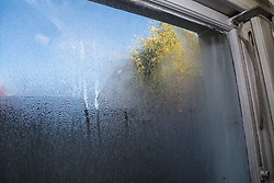 Condensation on the widows of the flat where Retired James Gosling, 58, is involved in a long running dispute with Camden council that began when his flat was flooded with sewage. West Hampstead, London, October 25 2018.