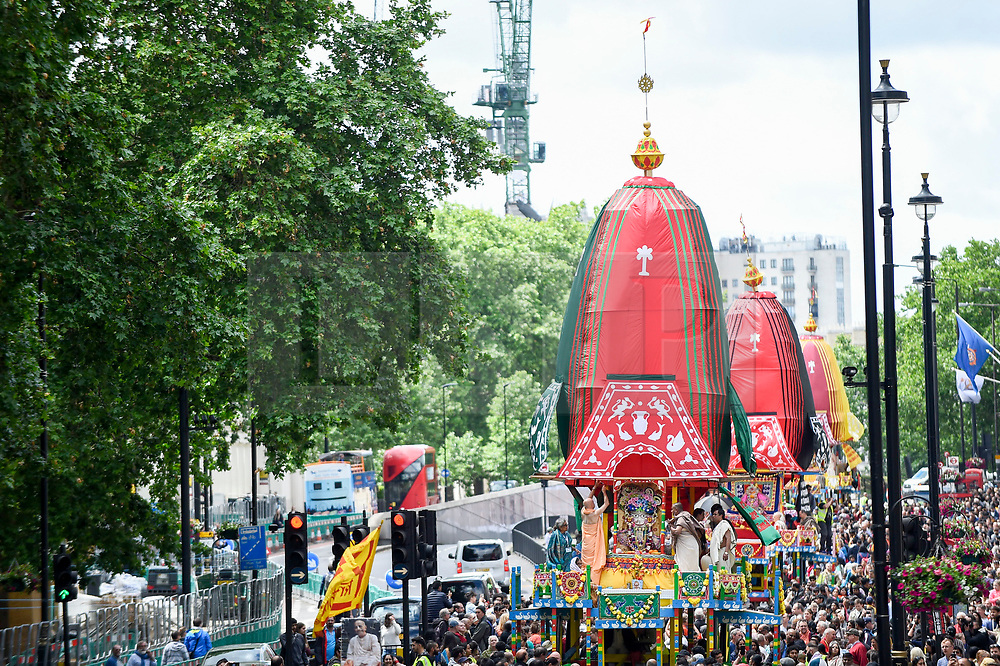 """© Licensed to London News Pictures. 16/06/2019. LONDON, UK.  Devotees celebrate the annual Rathayatra festival (""""cart festival""""), in central London.  Hare Krishna followers tow three huge decorated carts from Hyde Park corner to Trafalgar Square, singing and dancing all the way..  Photo credit: Stephen Chung/LNP"""