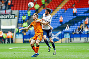 Wolverhampton Wanderers midfielder Diogo Silva (18), on loan from Athletico Madrid, challenges with Bolton Wanderers midfielder Will Buckley (11)  during the EFL Sky Bet Championship match between Bolton Wanderers and Wolverhampton Wanderers at the Macron Stadium, Bolton, England on 21 April 2018. Picture by Simon Davies.