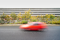 A car travels past Preston Bus Station, Lancashire, UK. Opened in 1969. Designed by BDP