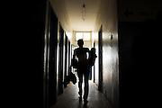 A woman carries her child as she walks through a corridor at the Ola During Children's Hospital in Freetown on Tuesday April 27, 2010. The Sierra Leone government announced today the abolition of medical fees for pregnant and lactating women as well as children under the age of 5.