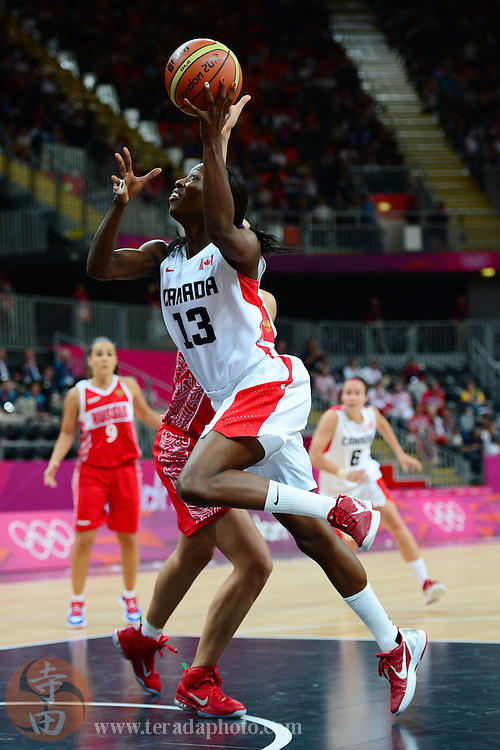 Jul 28, 2012; London, United Kingdom; Canada forward Tamara Tatham (13) shoots the ball against Russia during the second half at Basketball Arena. Russia defeated Canada 58-53.