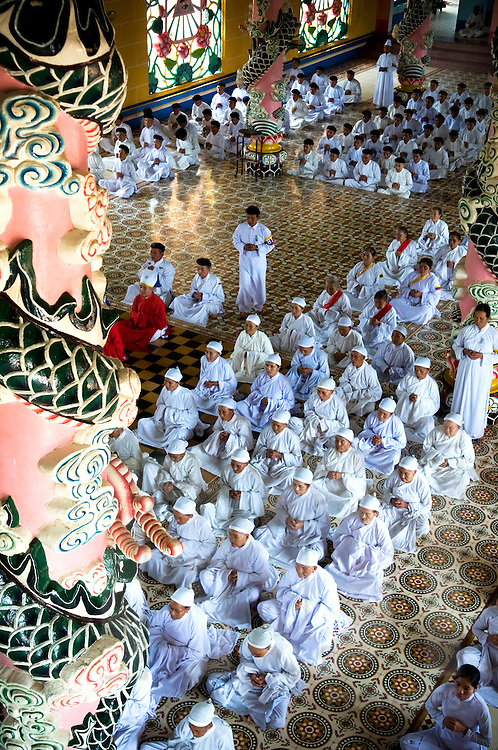 Worshippers in Cao Dai temple, Tay Ninh Province, Vietnam, Southeast Asia