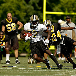 August 1, 2010; Metairie, LA, USA; New Orleans Saints wide receiver Adrian Arrington runs from cornerback Leigh Torrence (24) during a training camp practice at the New Orleans Saints practice facility. Mandatory Credit: Derick E. Hingle