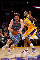 06 November 2009: Center Marc Gasol of the Memphis Grizzles drives to the basket while being defended by DJ Mbenga of the Los Angeles Lakers during the first half of the Lakers 114-98 victory over the Grizzles at the STAPLES Center in Los Angeles, CA.