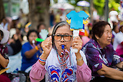16 MAY 2014 - BANGKOK, THAILAND: A PDRC supporter at a picket of the Thai Parliament complex. Thousands of protestors from the People's Democratic Reform Committee (PDRC) surrounded the Thai Parliament complex Saturday to pressure the Thai Senate to select an interim Prime Minister to replace ousted former PM Yingluck Shinawatra. The Senate decided not to appoint an interim PM of their own and announced a meeting with the current interim Prime Minister. The protestors left the parliament complex and threatened to return in larger numbers if the Senate doesn't act. The Senate appointment of an acting PM could plunge Thailand into chaos since there is already an interim Prime Minister from the ruling Pheu Thai party.     PHOTO BY JACK KURTZ