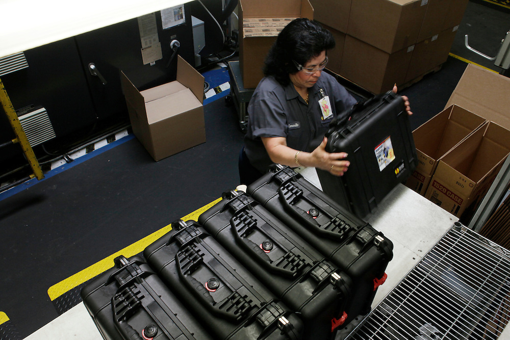 A worker packages an injection-molded plastic hardshell case at the Pelican Products Inc. production facility in Torrance, California, U.S., on Thursday, March 8, 2012.  © 2012 Patrick T. Fallon