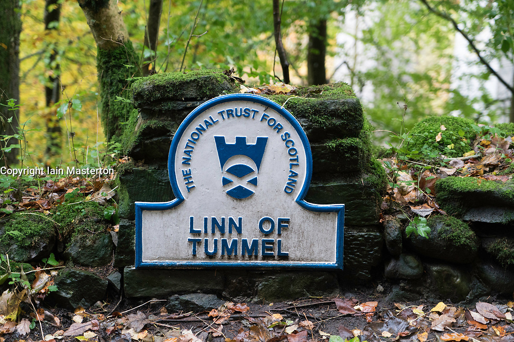 Sign marking Linn of Tummel  in natural woodland on banks of River Garry at historic Pass of Killiecrankie near Pitlochry.
